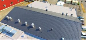 Seattle Cook House Metal & Flat Roof with a Nu-Ray NRM-5000 standing seam metal roof