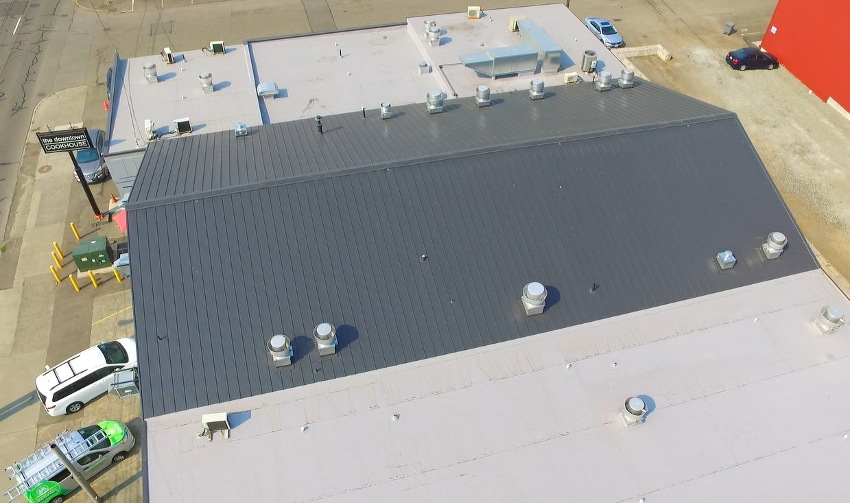 We installed a new Weatherbond in Seattle Cook House Metal & Flat Roof project
