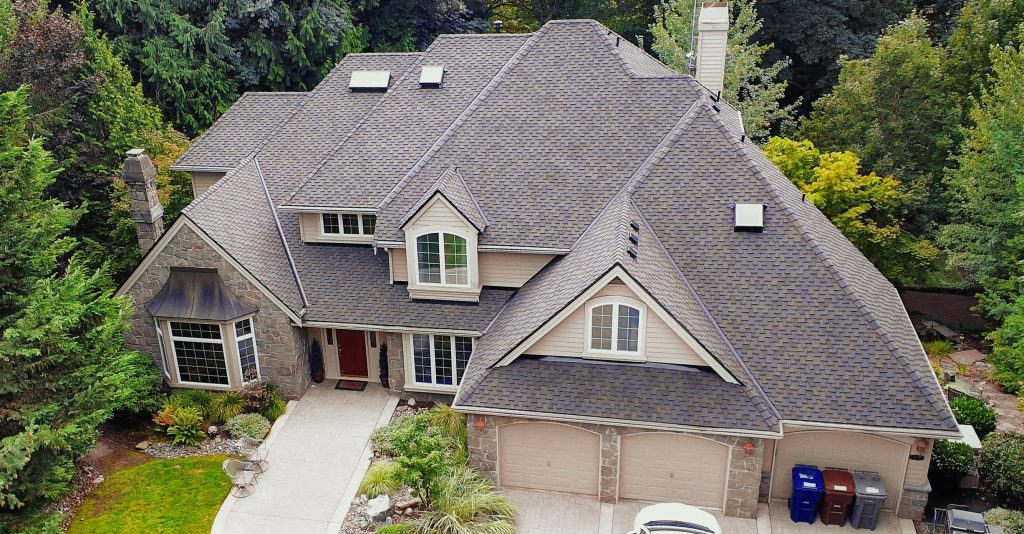 Aerial view of new half inch CDX plywood and CertainTeed Presidential TL composition shingles