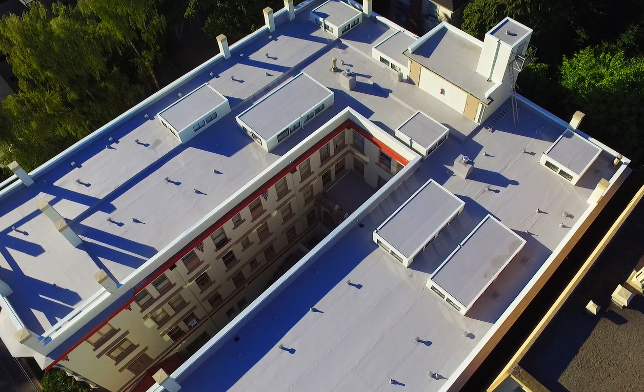 Residential & Commercial Roofing: Historic Chelsea Apartments With Modern TPO Roofing Top View from Distance