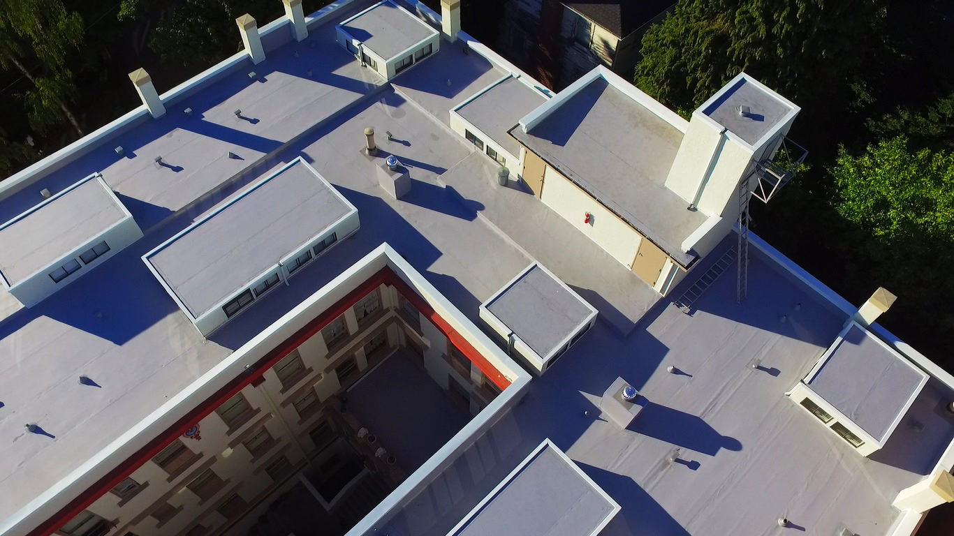 Residential & Commercial Roofing: Historic Chelsea Apartments With Modern TPO Roofing Top Back View